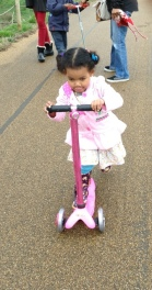 3-yo determination on the Mini Micro in Popping Pink with sequined scooter sleeve and a bell!